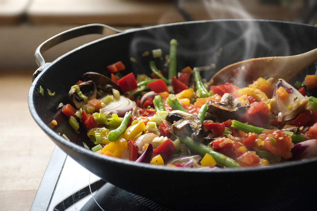 steaming mixed vegetables in a wok