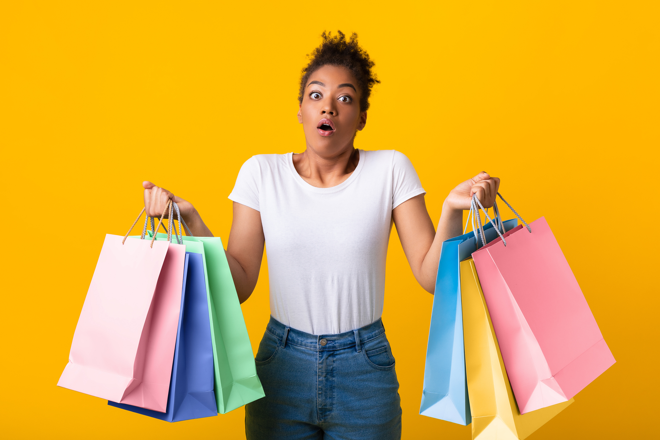 Portrait of a lady holding shopping bags