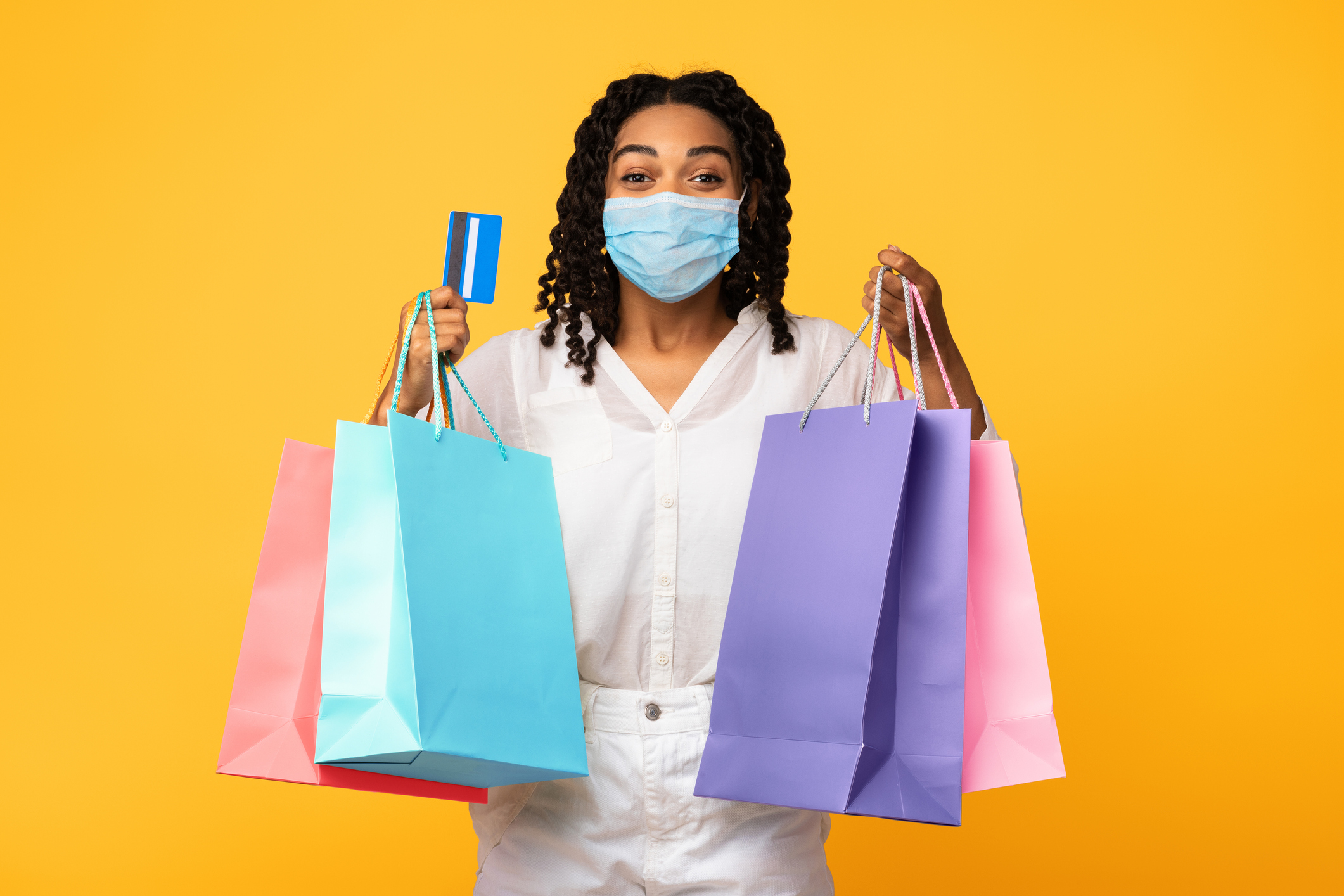 Shopping In Mask Holding Credit Card and Bags