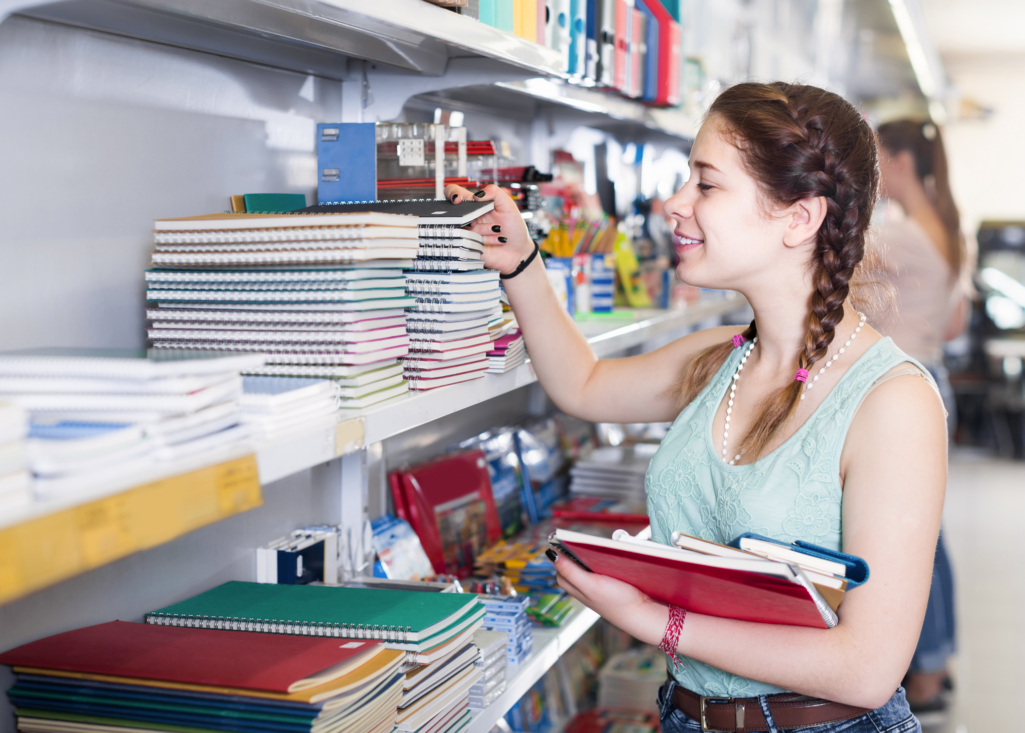 buying different products in stationery shop